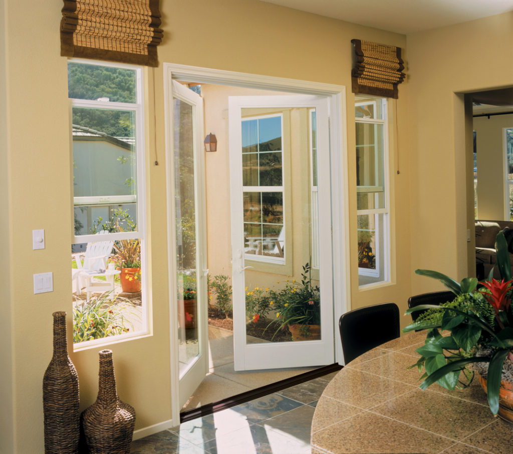 Retrofit out swing doors